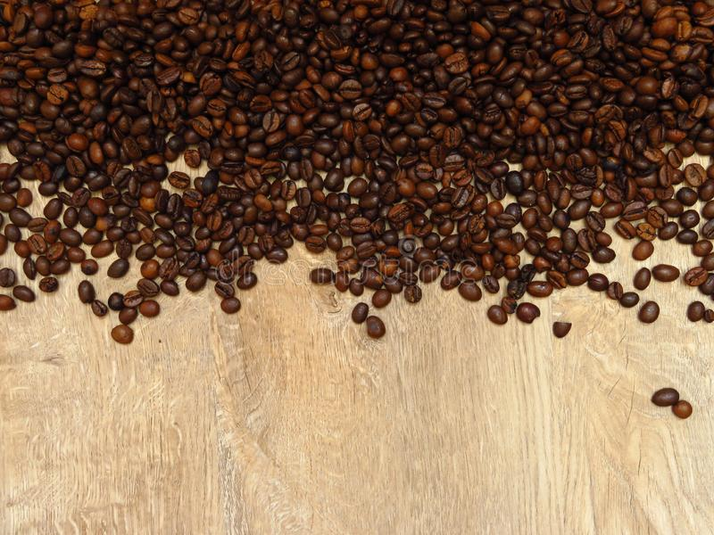 Coffee beans on fine oak tree wood texture pattern background. Space for text. stock photos