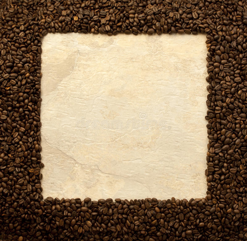 Coffee beans frame. Frame made of dark brown coffee beans stock photography