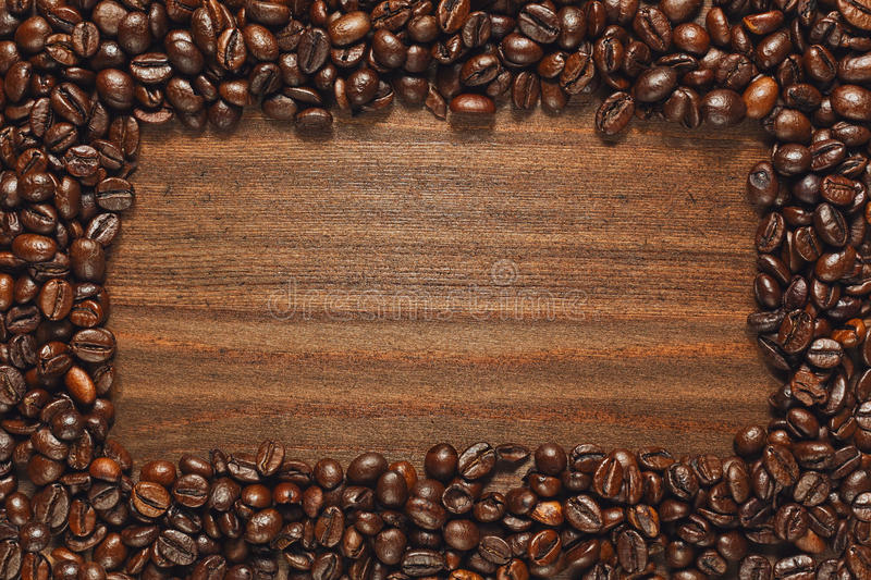 Coffee beans frame on wooden table stock photo