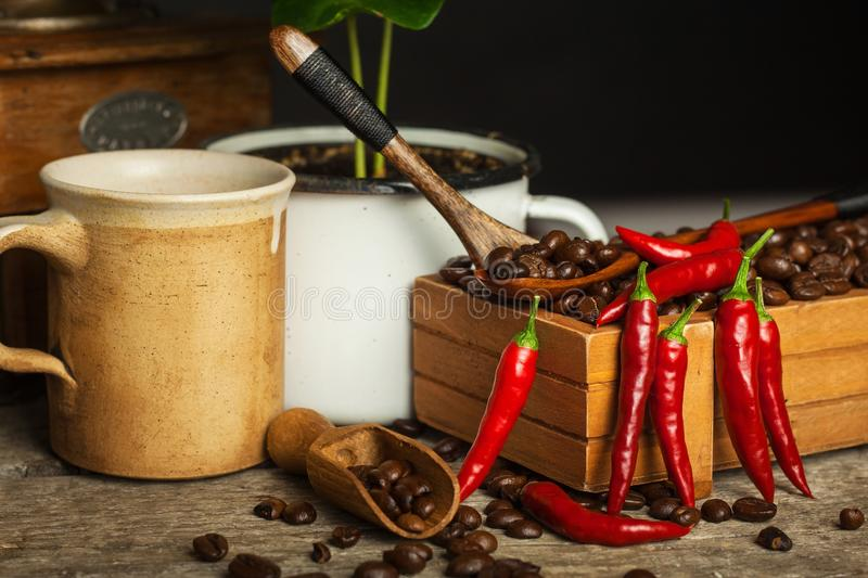 Coffee beans and fresh chili peppers. Trade in crops. Advertise for coffee shop. royalty free stock image
