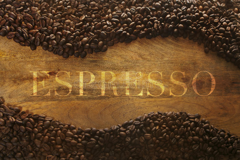 Coffee Beans. Freshly roasted coffee beans on top of a wooden table royalty free stock photography
