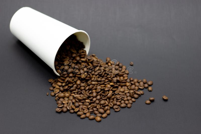 Coffee beans in a glass on a dark background place for text. Coffee beans in a glass on a dark background bridge for text stock photos