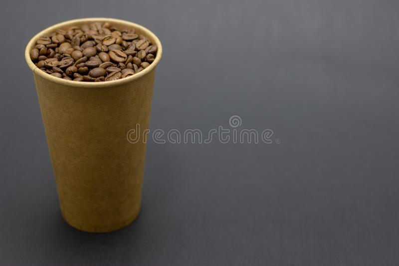 Coffee beans in a glass on a dark background place for text. Coffee beans in a glass on a dark background bridge for text stock image