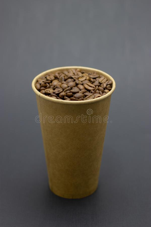 Coffee beans in a glass on a dark background place for text. Coffee beans in a glass on a dark background bridge for text royalty free stock image