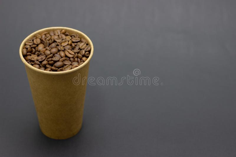 Coffee beans in a glass on a dark background place for text. Coffee beans in a glass on a dark background bridge for text royalty free stock photography