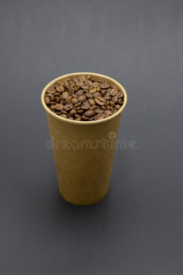 Coffee beans in a glass on a dark background place for text. Coffee beans in a glass on a dark background bridge for text stock photography