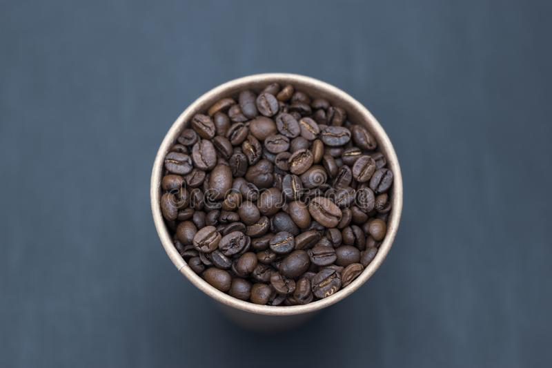 Coffee beans in a glass on a dark background place for text. Coffee beans in a glass on a dark background bridge for text royalty free stock photos