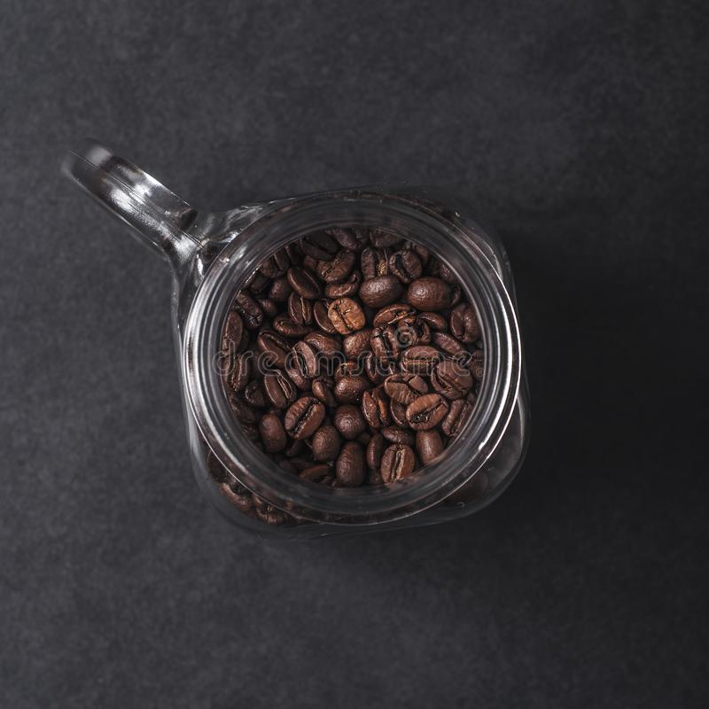 Coffee beans in glass jar royalty free stock images