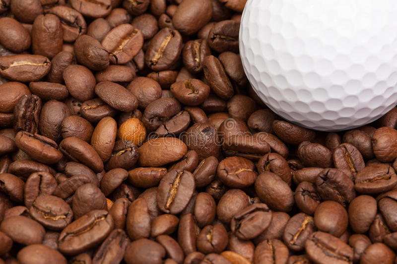 Coffee beans and golf ball royalty free stock photography