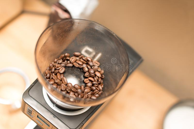 Coffee beans in grinder stock photos