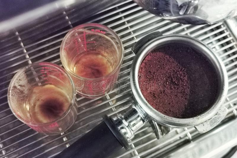 The coffee beans are ground and ground into a coffee stem for espresso with machine royalty free stock photography