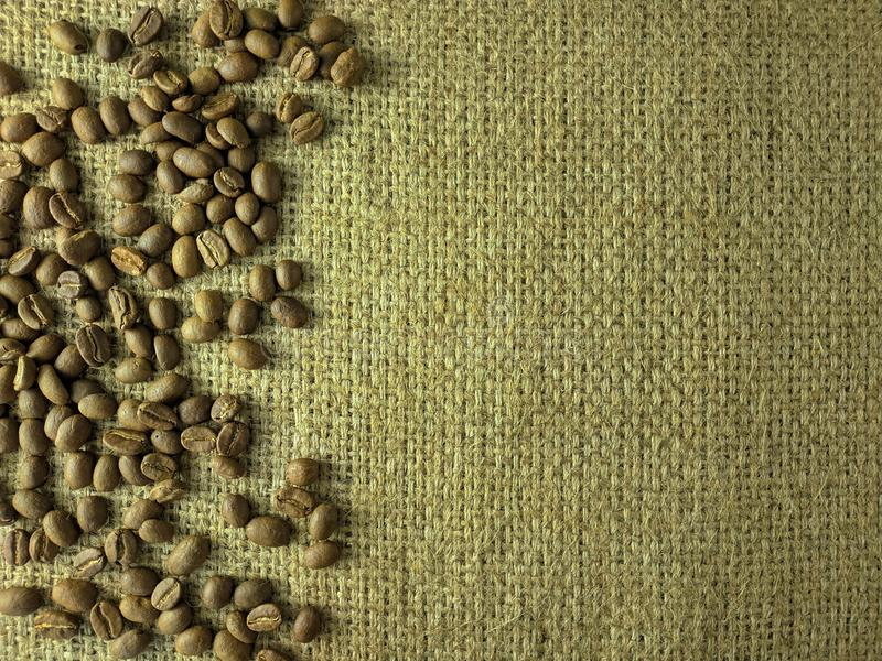 Coffee beans on gunny texture stock photos