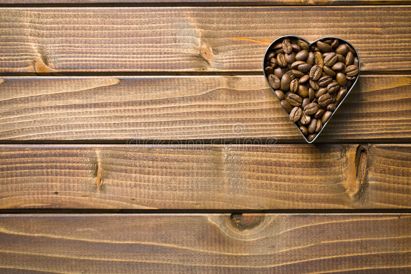 Download Coffee beans in heart form stock image. Image of bitter - 34411187