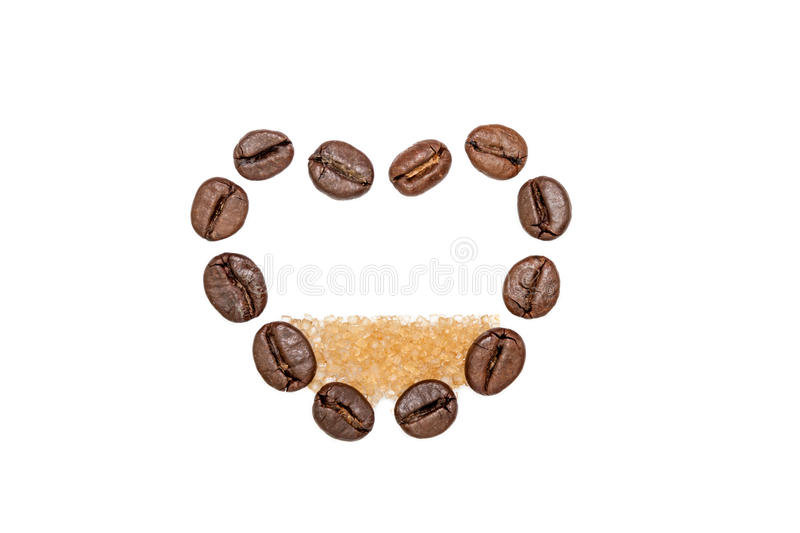 Coffee beans heart with sugar. Heart shape made from coffee beans filled with brown sugar royalty free stock photos