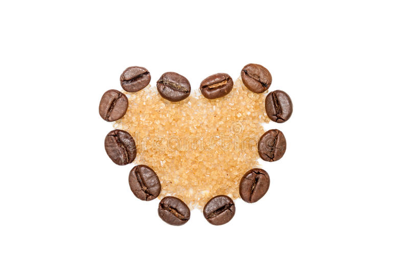 Coffee beans heart with sugar. Heart shape made from coffee beans filled with brown sugar stock photography