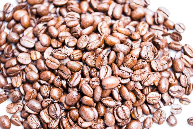 Coffee beans high key. Brown stock photos