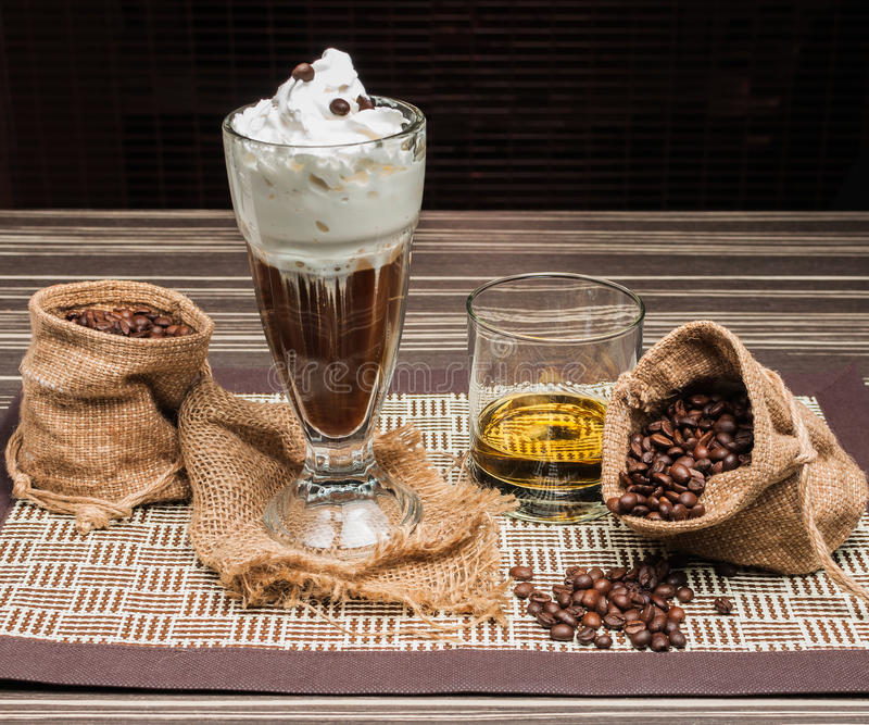 Coffee beans. Irish coffee with cream and milling coffee beans stock photo