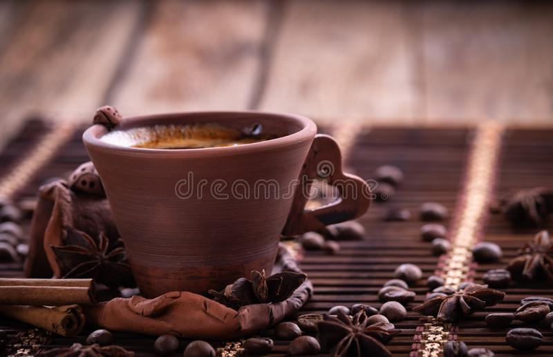 Coffee beans in jute bag with coffee grinder stock image