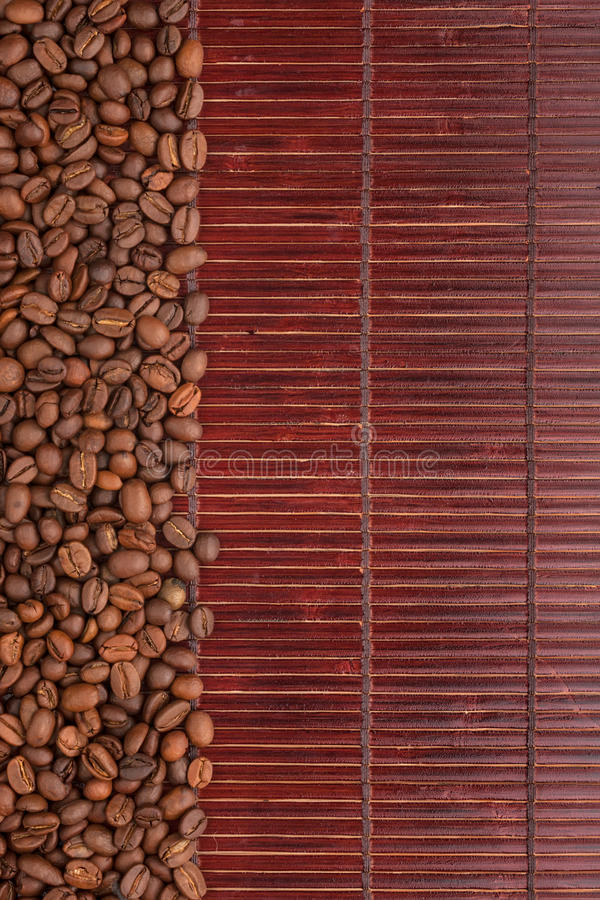 Coffee beans lying on a bamboo mat