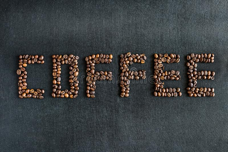Coffee Beans Making the Word Coffee. On black friday stock image