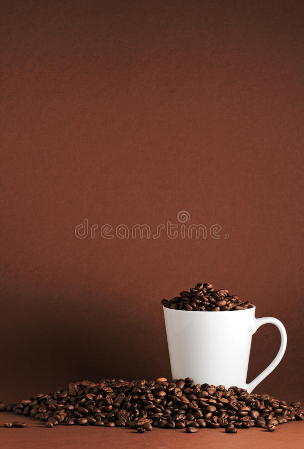 Coffee beans and mug port stock photos