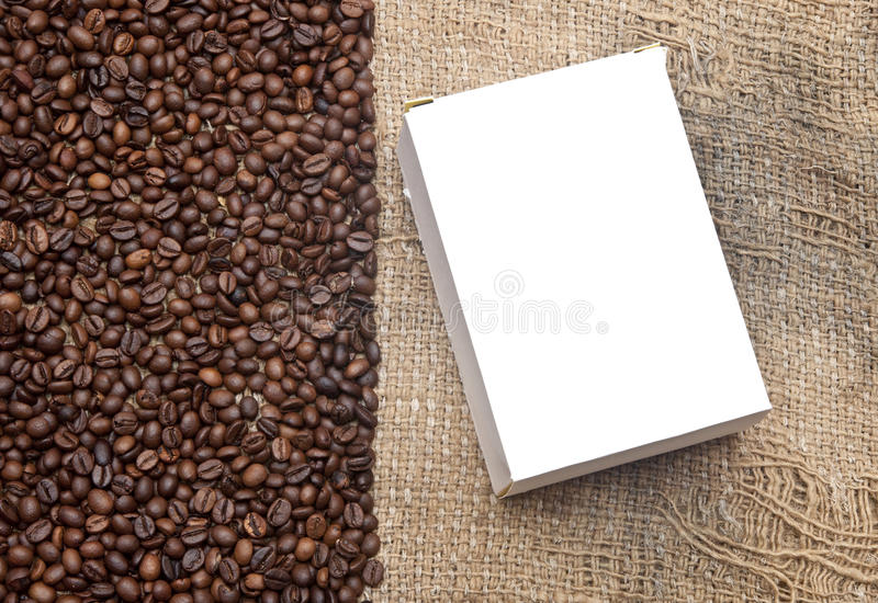 Coffee beans on old burlap royalty free stock photos