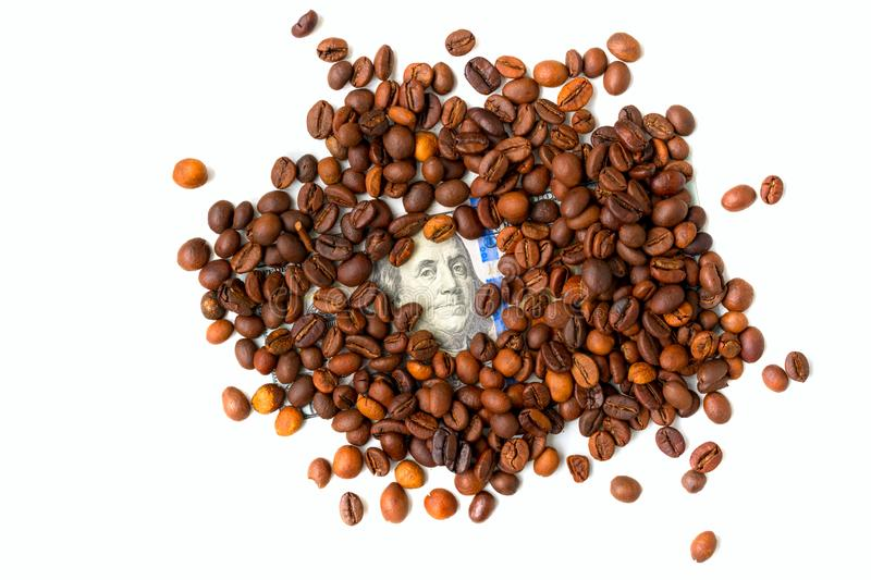 Coffee beans and one hundred dollar bill. Roasted coffee beans background. Financial concept. Isolated on white background stock photos
