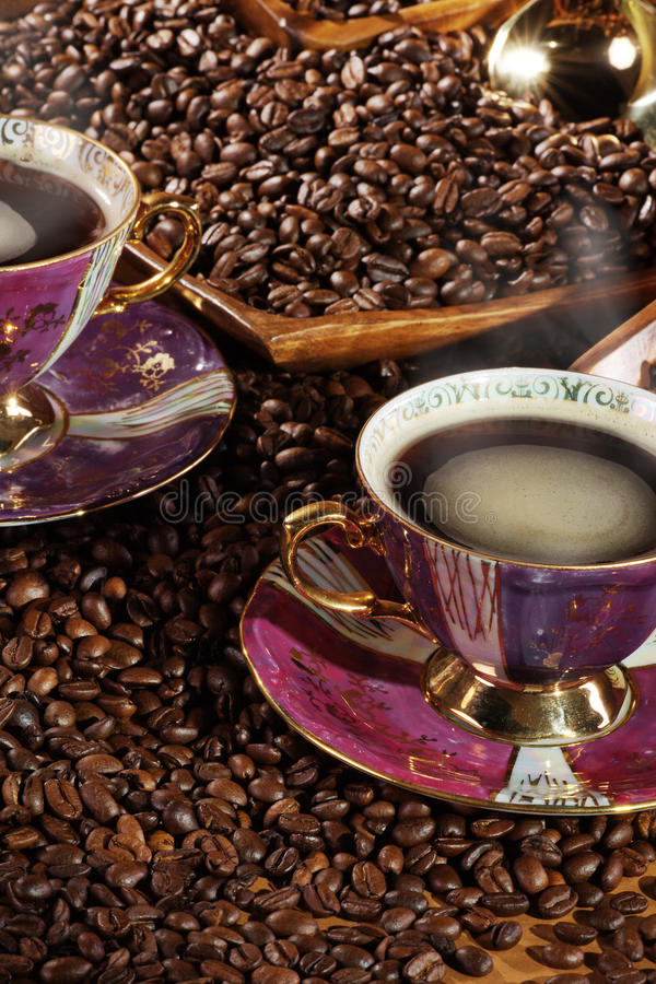 Coffee beans. And oriental cup with hot coffee royalty free stock image