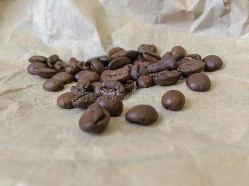 Coffee beans on paper background. Closeup photo stock photos