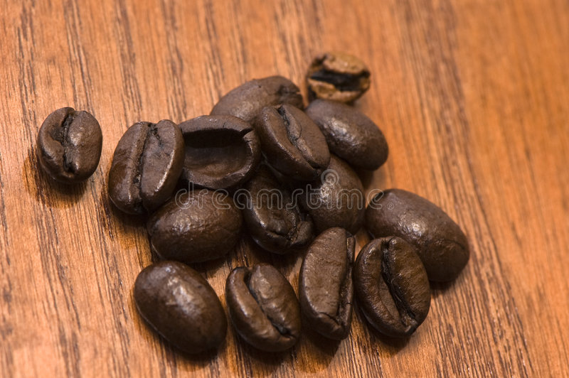 Coffee beans on red wood royalty free stock photo