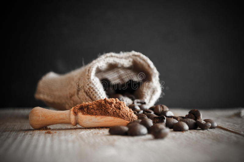 Coffee beans in a sack stock image