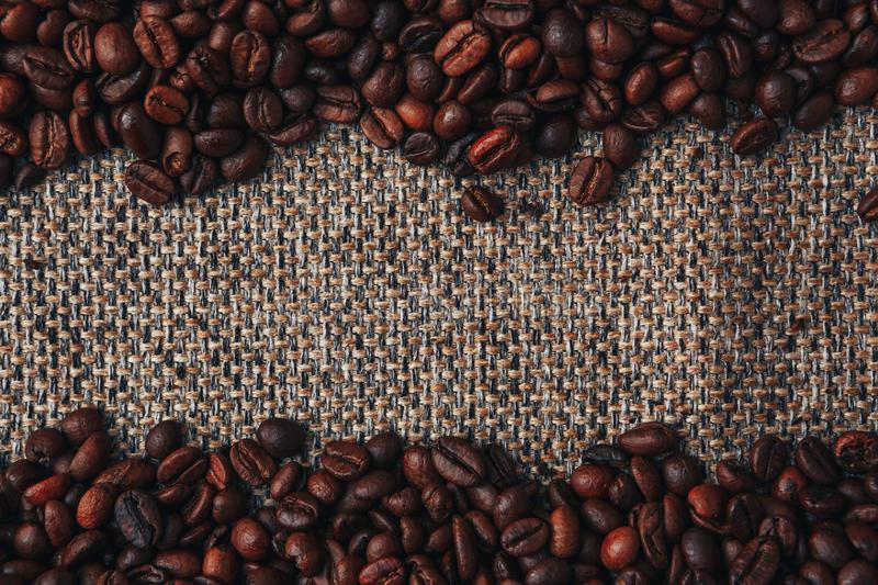 Coffee beans and sackcloth background. Copy Space stock images