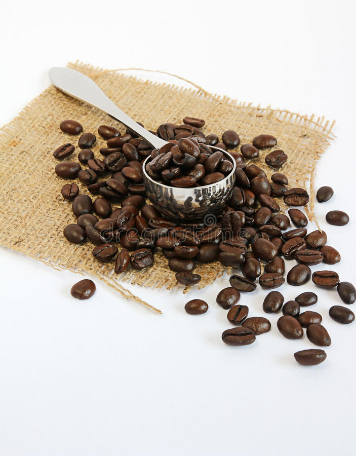 Coffee Beans And Scoop On Hessian Stock Photos