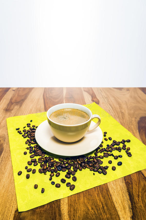 Coffee With Beans On Serviette Royalty Free Stock Photo