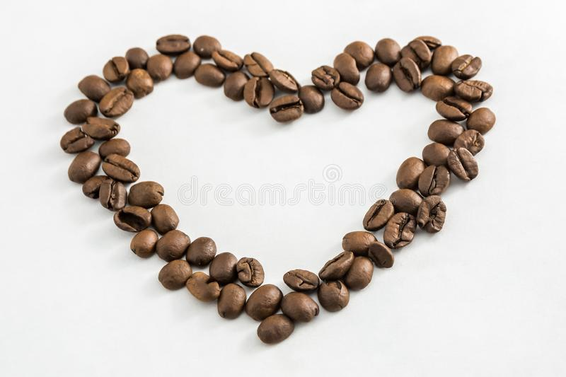 Coffee beans in the shape of a heart royalty free stock photo