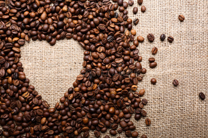 Coffee beans in shape of heart stock photography