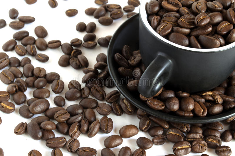 Coffee beans in a small cup royalty free stock photo