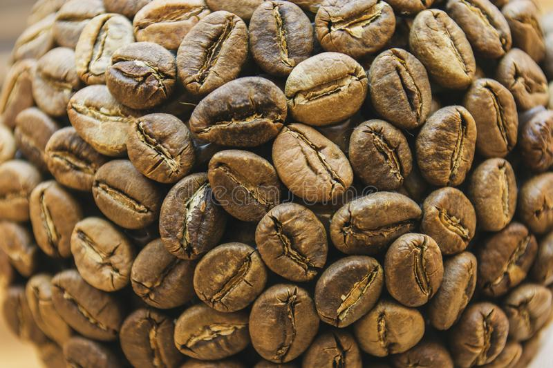 Coffee beans souvenir. On a beautiful background royalty free stock photo
