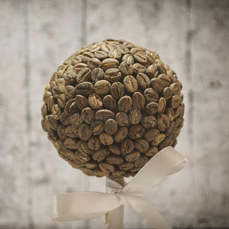 Coffee beans souvenir. On a beautiful background royalty free stock photos