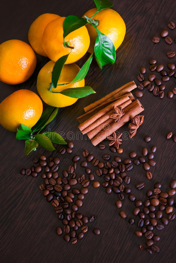 Coffee beans with spices on the old wooden boards. , cinnamon, nuts, star anise stock image
