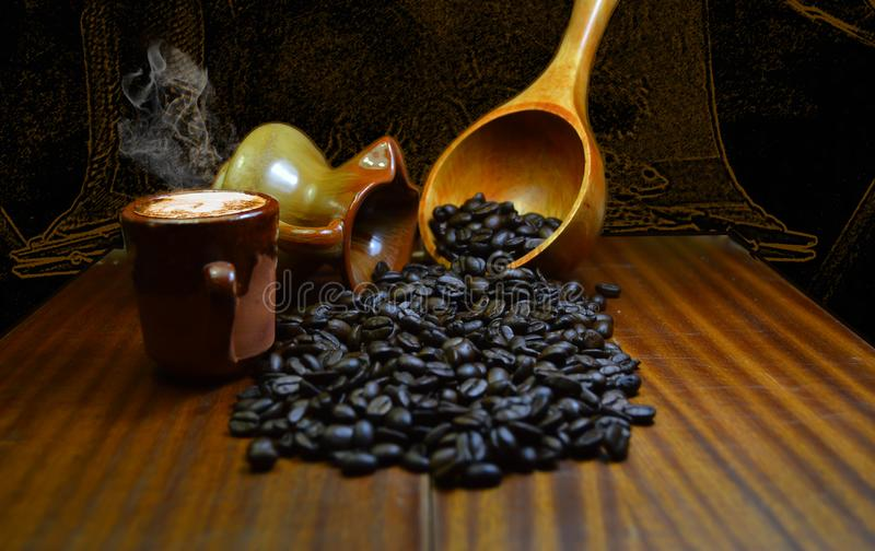 Coffee beans. Spilled on a wooden table from old ceramic pots, photo from 2019 stock photos