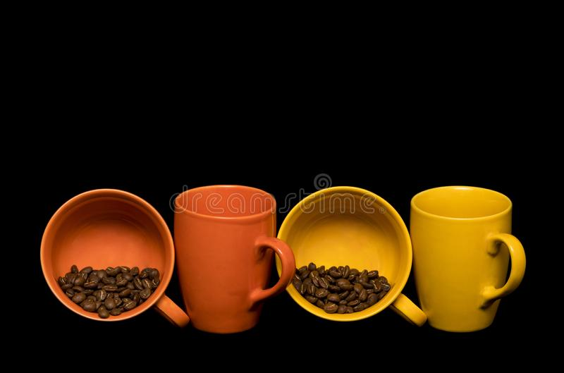Coffee beans spread around coffee mugs stock photography