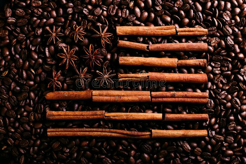 Coffee beans, star anise and cinnamon in the shape of the American flag. Fragrant spices for coffee drink, close-up, concept royalty free stock images