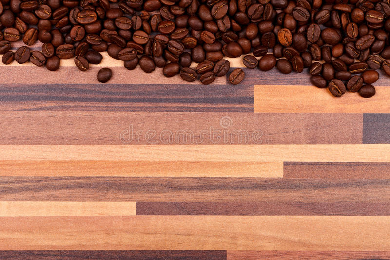 Coffee beans on striped table stock image