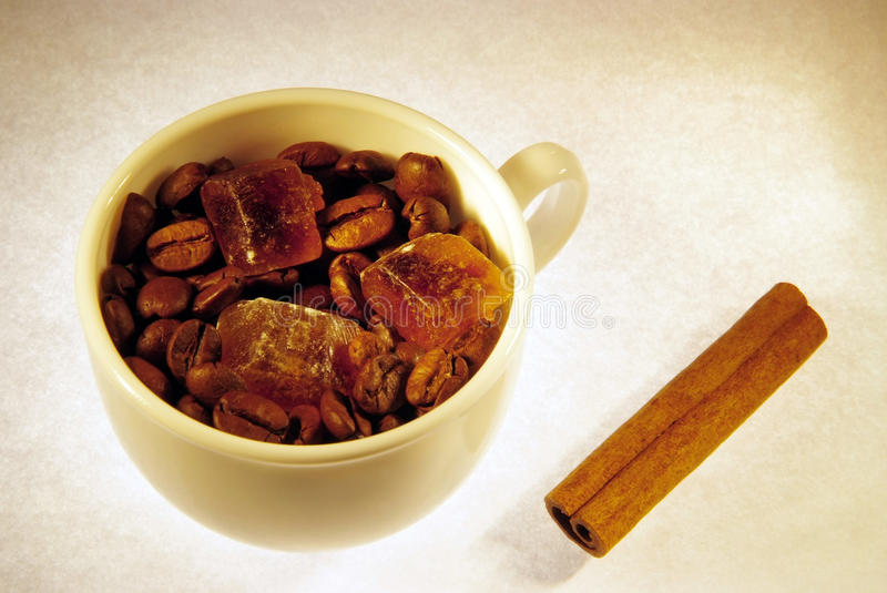 Coffee beans, sugar crystals and cinnamon stock images