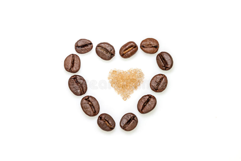 Coffee beans and sugar heart. Heart shape made from coffee beans and brown sugar royalty free stock images