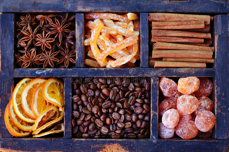 Coffee beans, sugared orange and kumquats and spices royalty free stock image