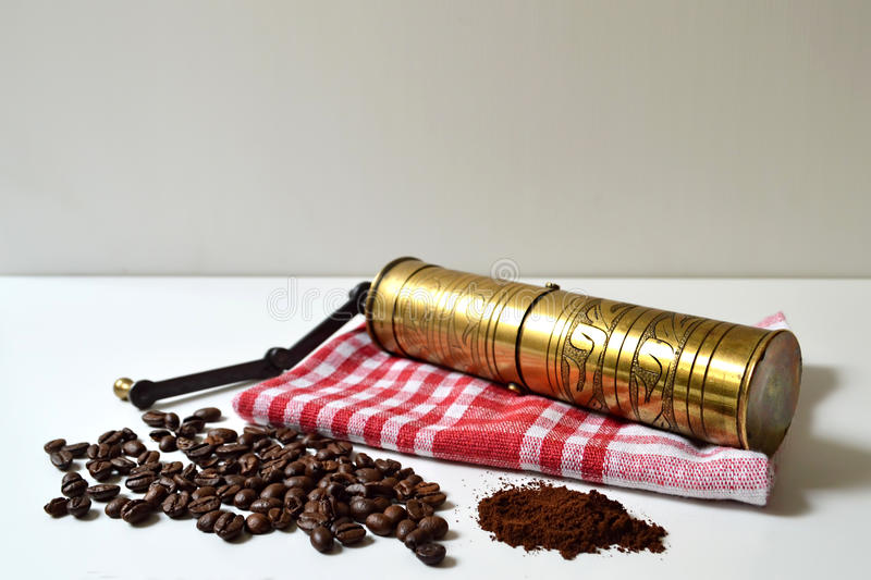 Coffee beans, vintage grinder and ground coffee stock photo