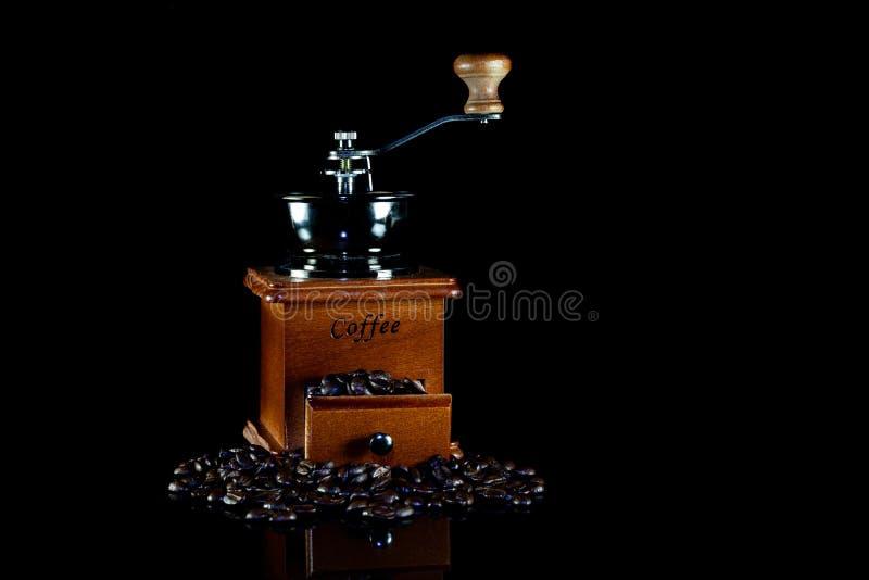 Coffee beans and vintage wooden coffee grinder on black background. Antique, aroma, bag, beverage, break, breakfast, brew, brewed, brown, cafe, caffeine stock photos