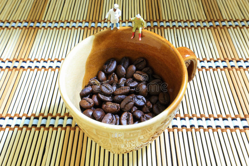 Coffee beans watching stock photos